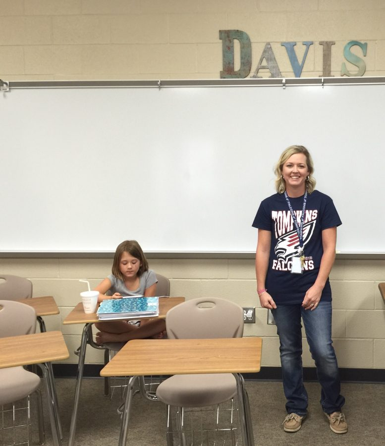 Sandi Davis preparing lessons for the first day with her daughter.
