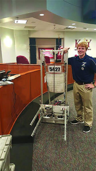 Senior Conor Devlin with the award winning robot.