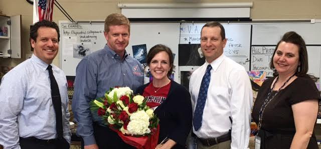 Christie Skinner receiving the teacher of the year award.