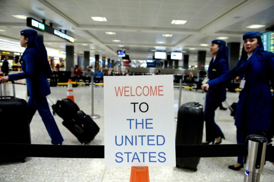 A sign at Washington Dulles International Airport welcomes travelers. A three-judge panel decided not to reinstate President Trumps travel ban barring travelers from seven majority-Muslim nations.