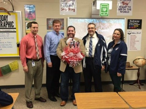 World Geography teacher Dax Nessosi received his 1st Year Teacher of the Year Award / PHOTO CONTRIBUTED