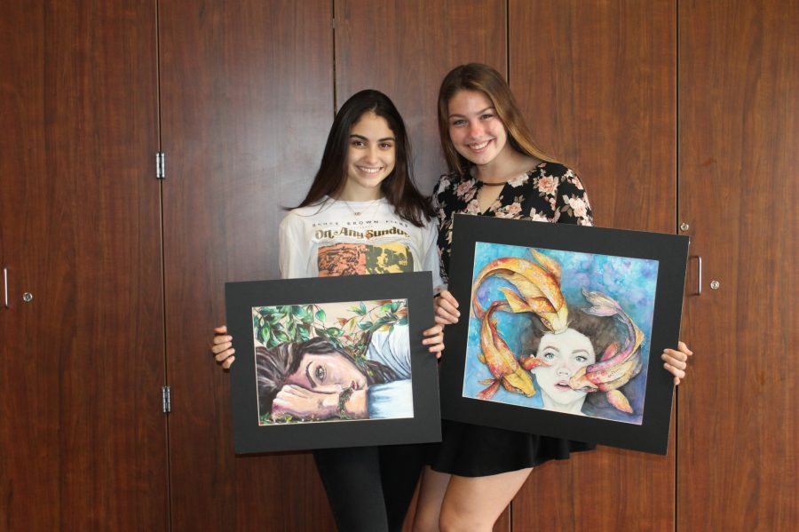 Juniors Montserrat Garcia and Seanna McCarty proudly present their VASE pieces. Their pieces took multiple months to draft, create and finalize.